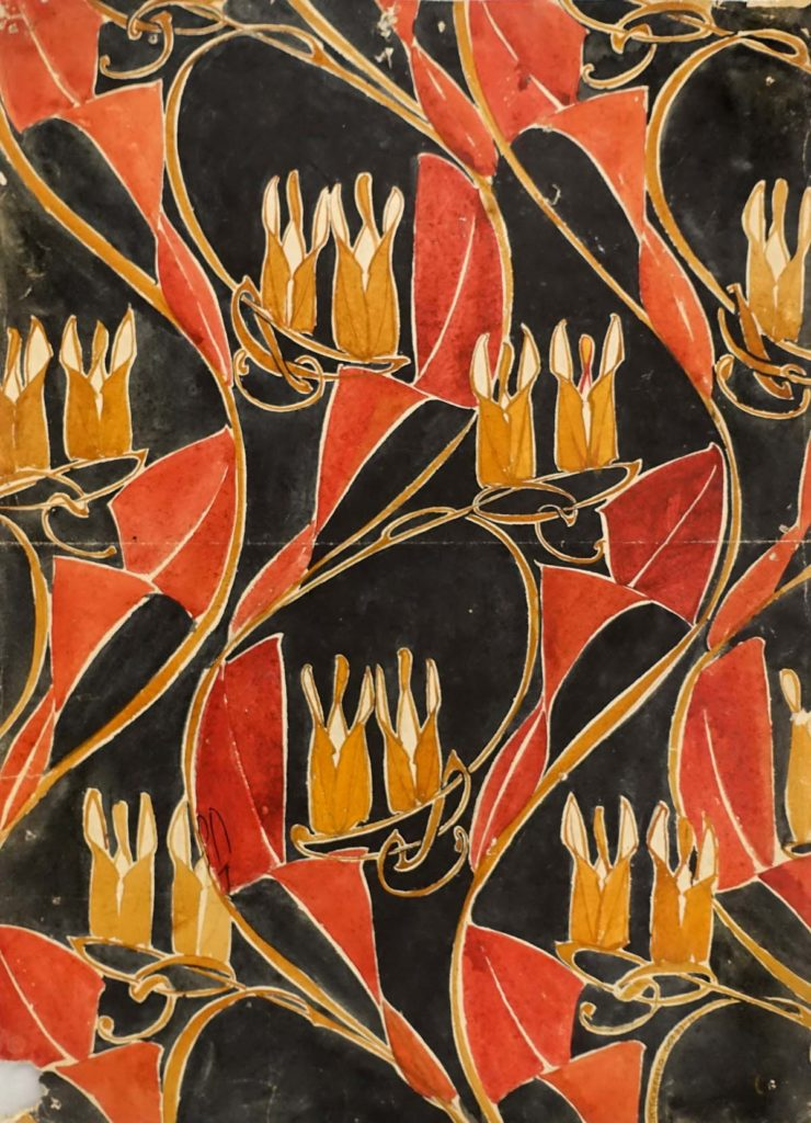 a floral paper design with orange and black