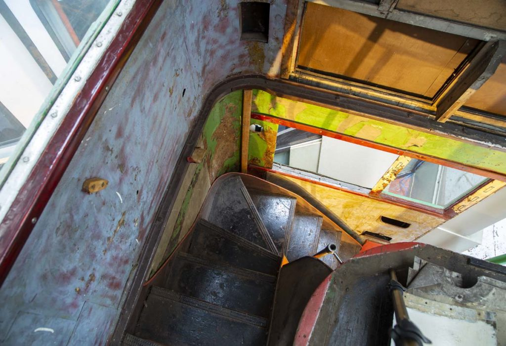 a photo of the back stairwell of a double decker bus