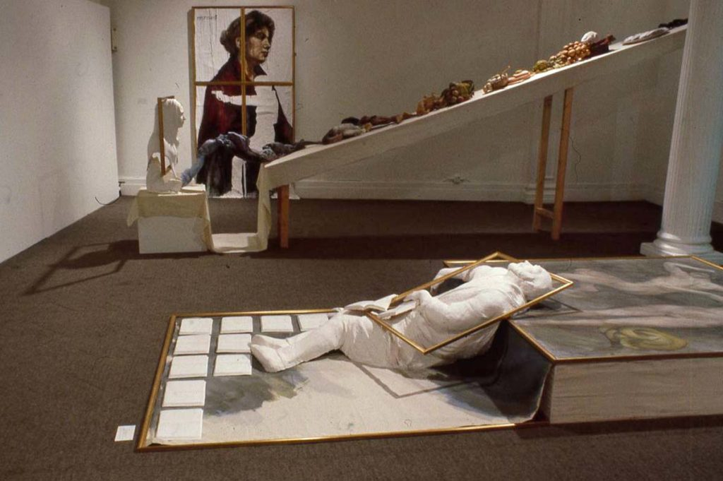 a photo of a gallery installation with sculptures and painting