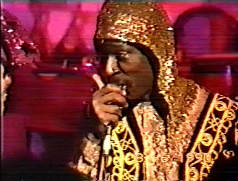 a photo of a jazz musician from the Sun Ra Arkestra in a golden cloak