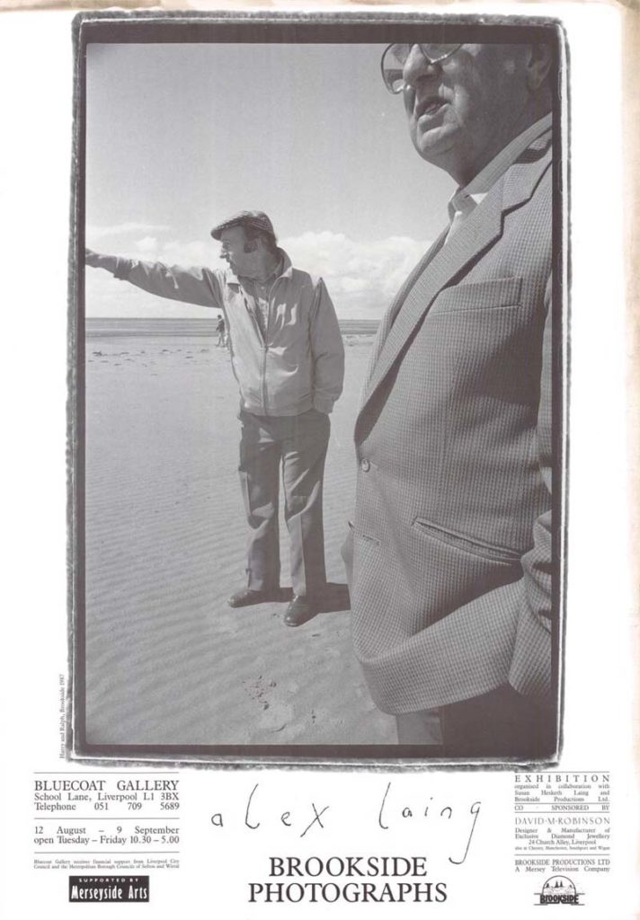 a poster with a photo of a two blokes on Crosby beach