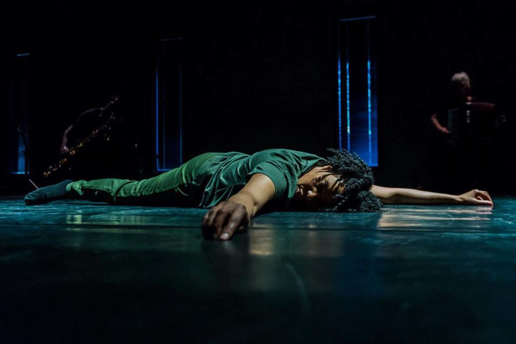 a film still of a woman laying prone on the floor