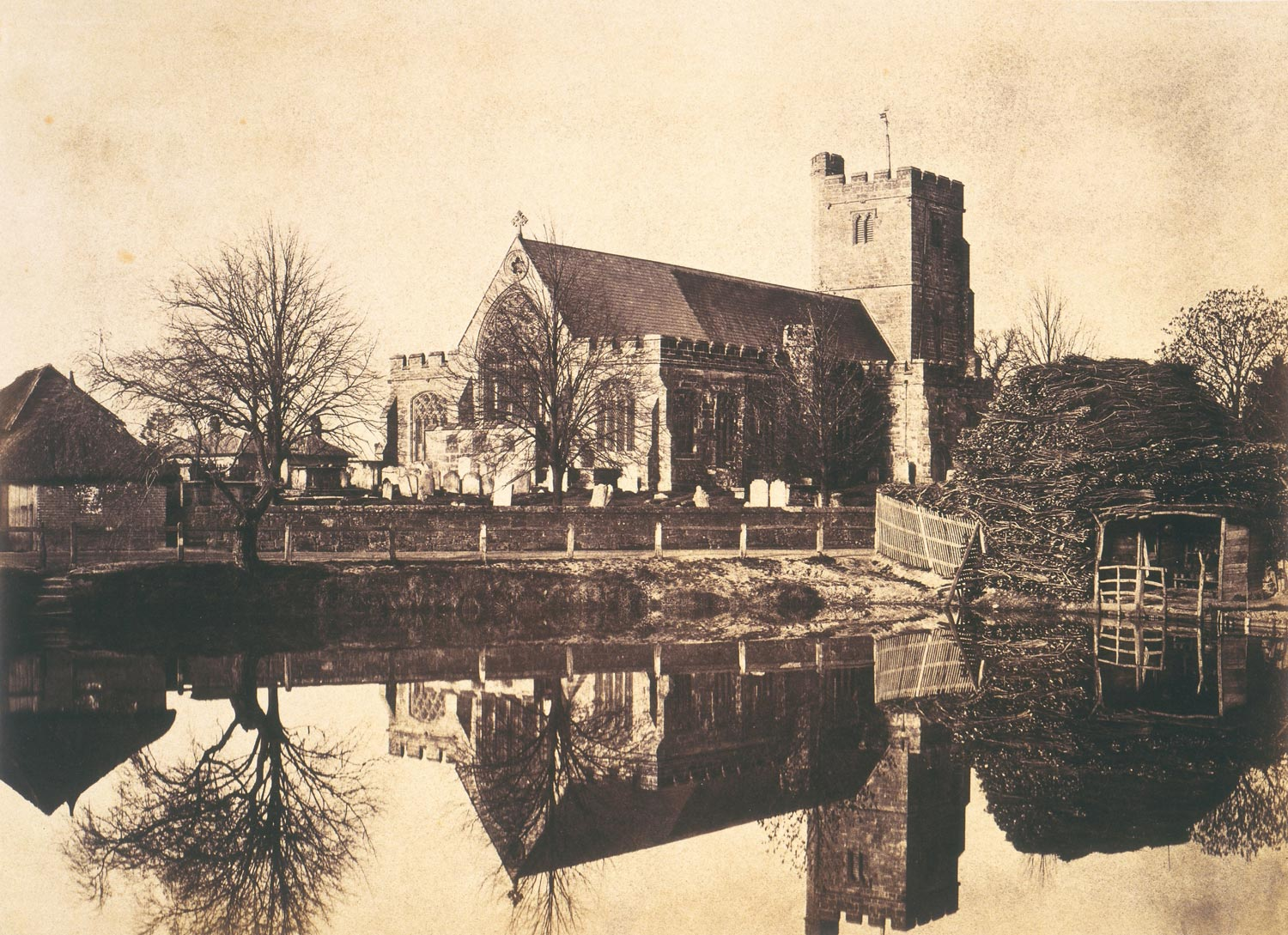 sepia toned image of a church overlooking a pond