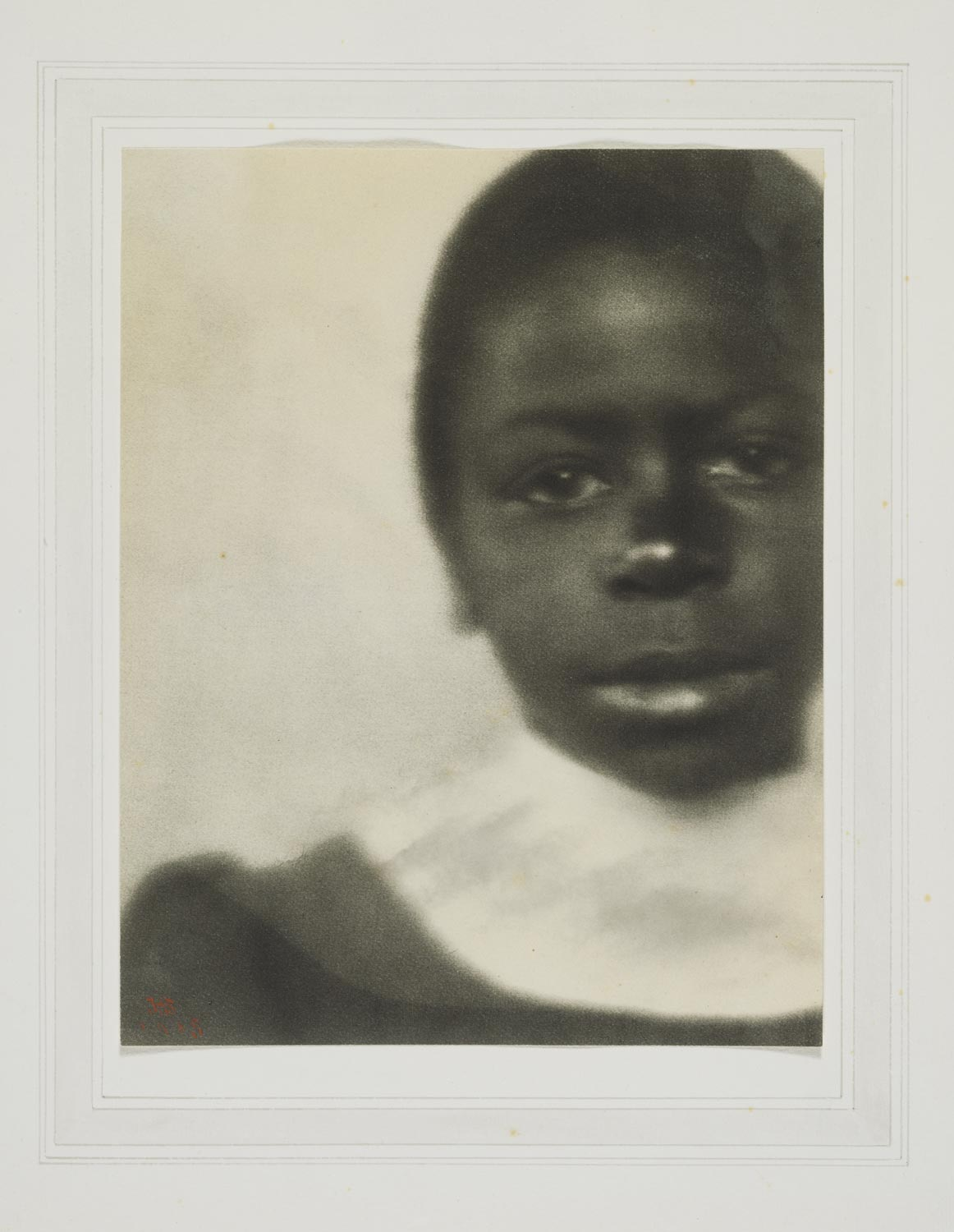 black and white cropped head and shoulders photograph of a young girl
