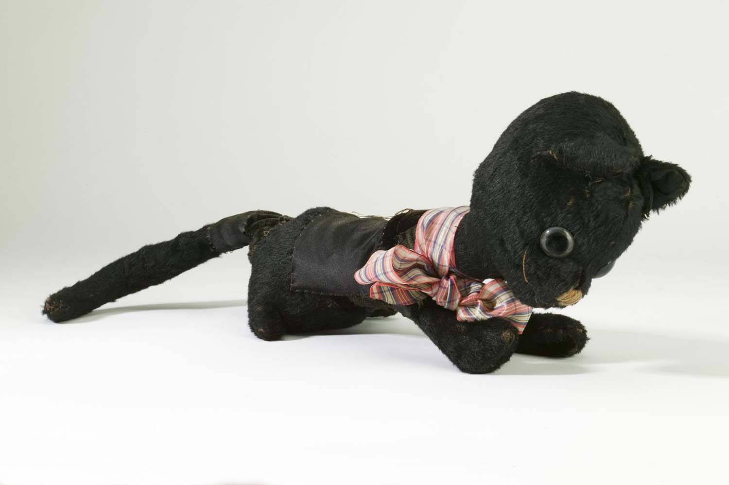 a photo of a black cat soft toy