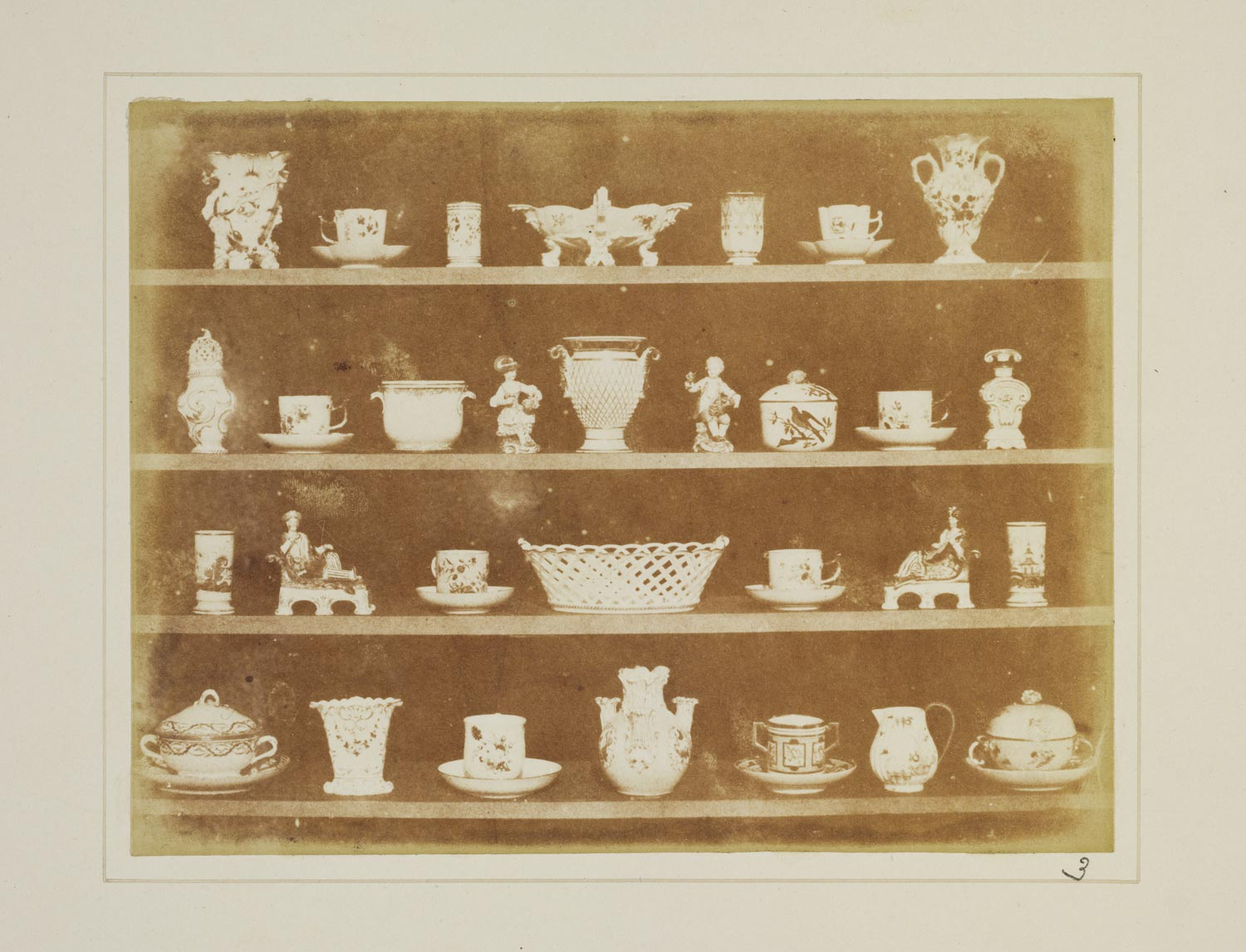 sepia toned image of a shelf containing objects made from china