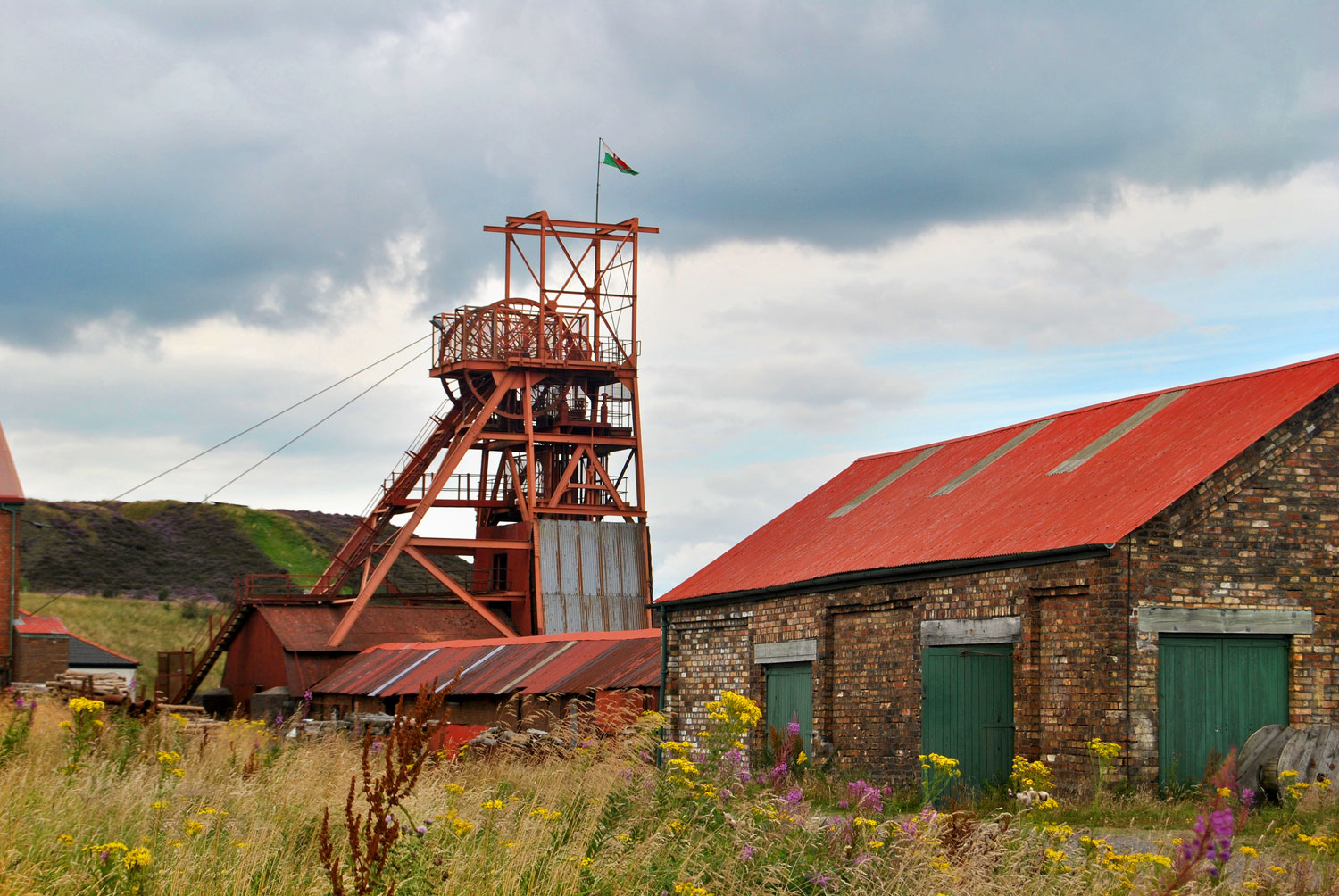 photograph of disused mining site showing winding engine and sheds
