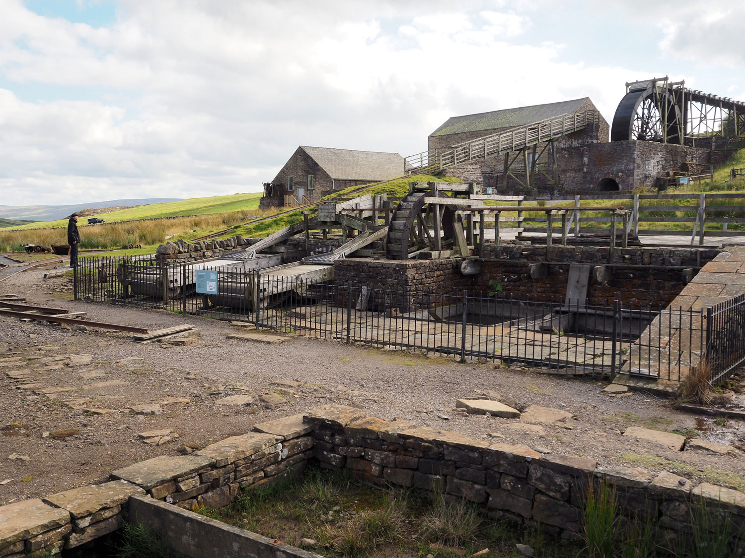 photograph of disused mining buildings and machinery