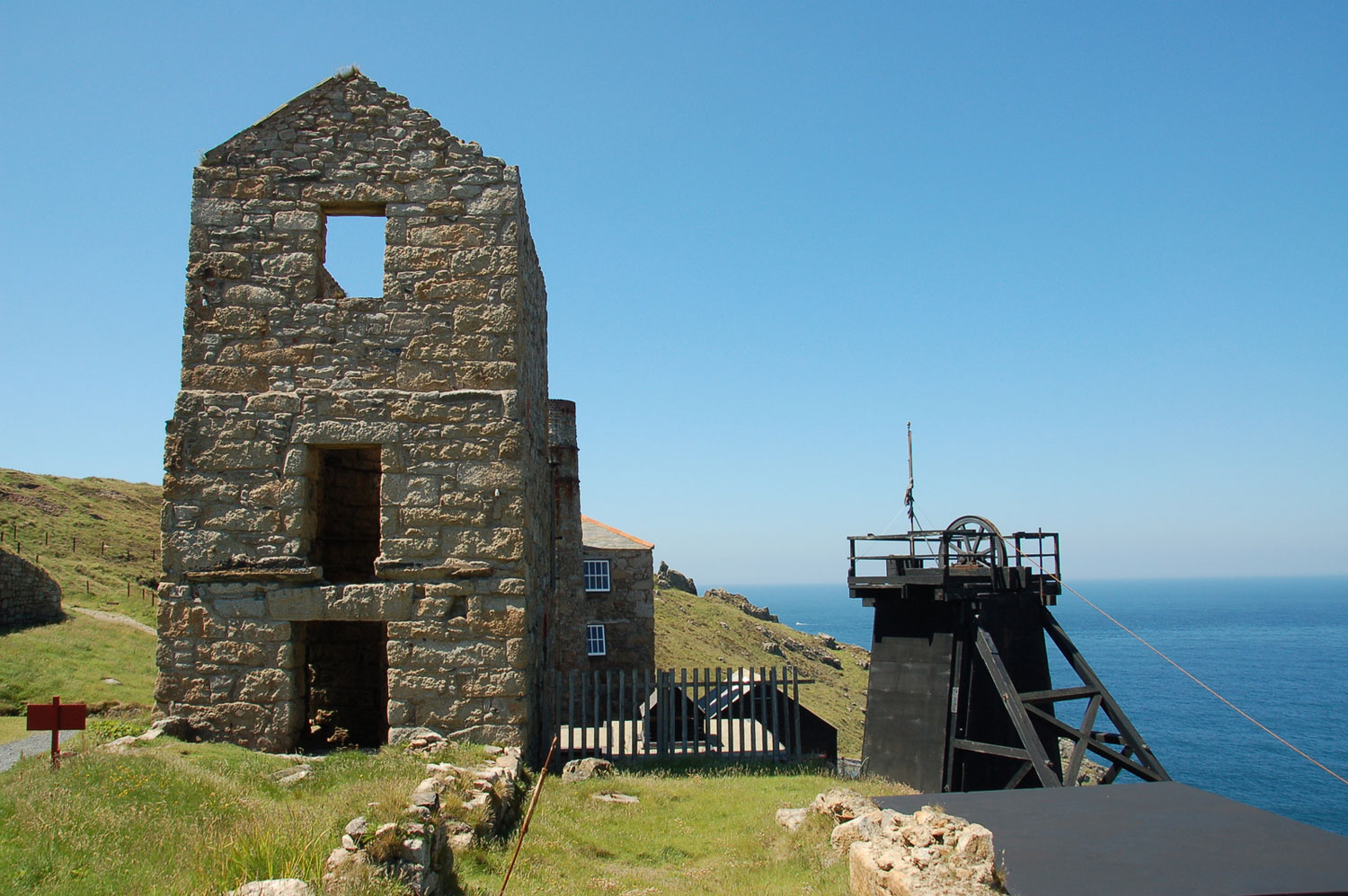 photograph of coastal ruined mine building and winding mechanism