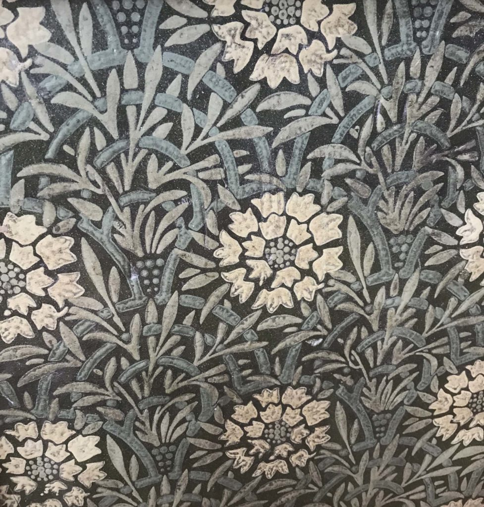 a photo of white and turquoise flower designs on linoleum