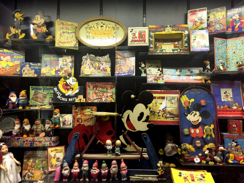 photograph of museum display showing mickey mouse toys and memorabilia