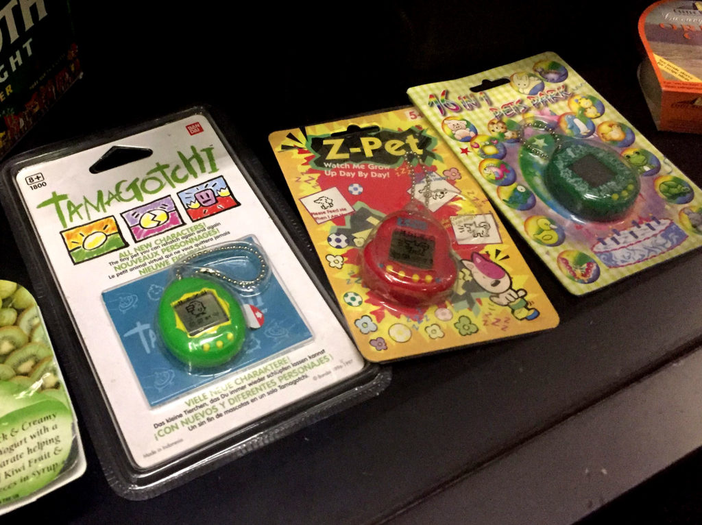 photograph of tamagotchis in packaging in museum display