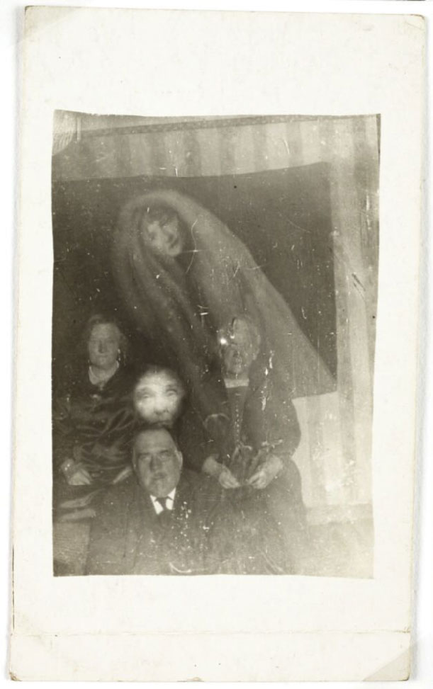 photograph portrait of three elderly people with ghost-life faces of two people around them