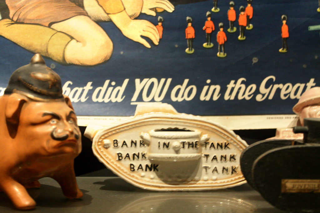 photograph of museum display showing ceramic tank, pig wearing helmet and poster reading 'what did YOU do in the Great War'
