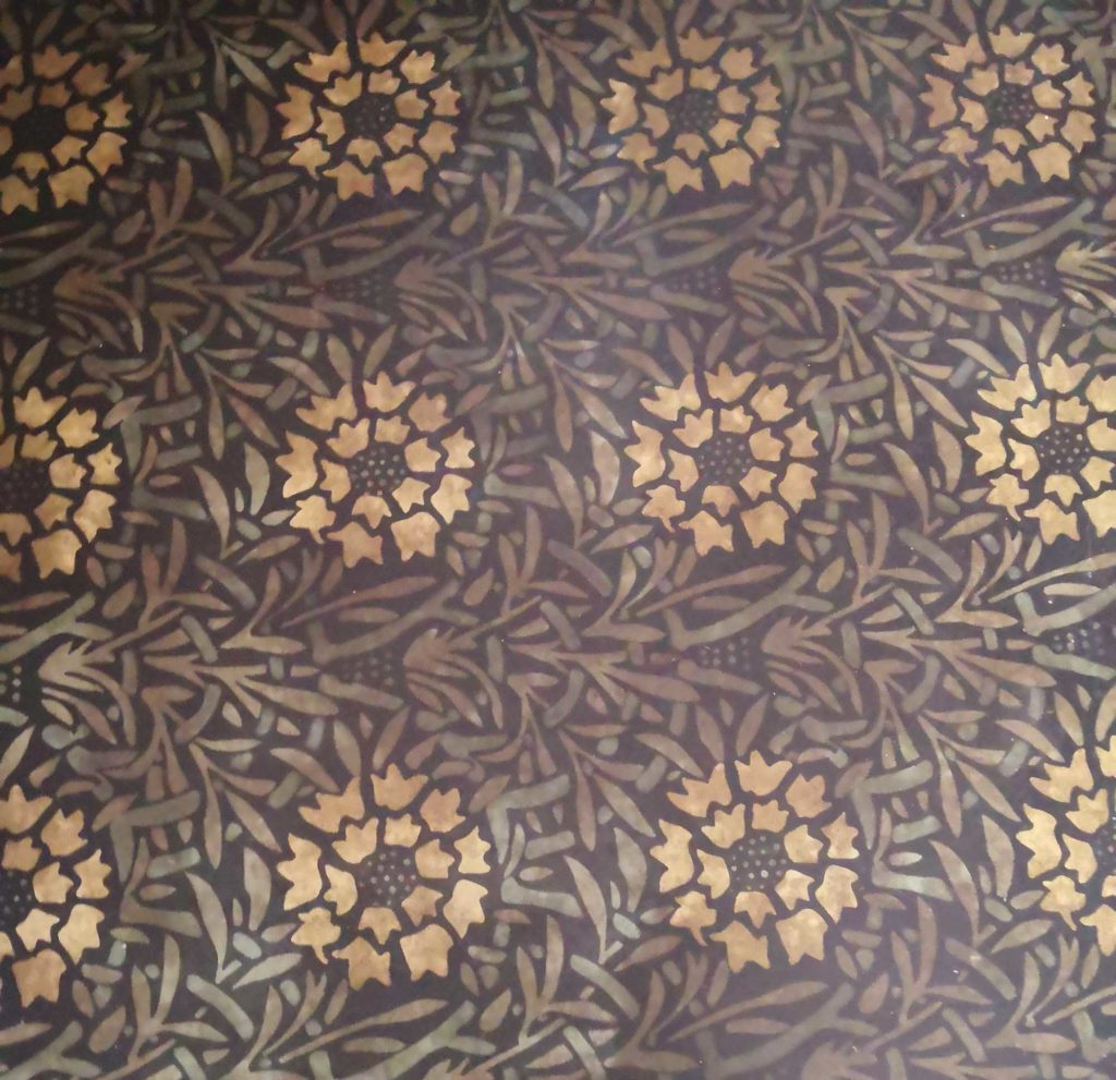 a photo of green and gold lino in a marigold pattern