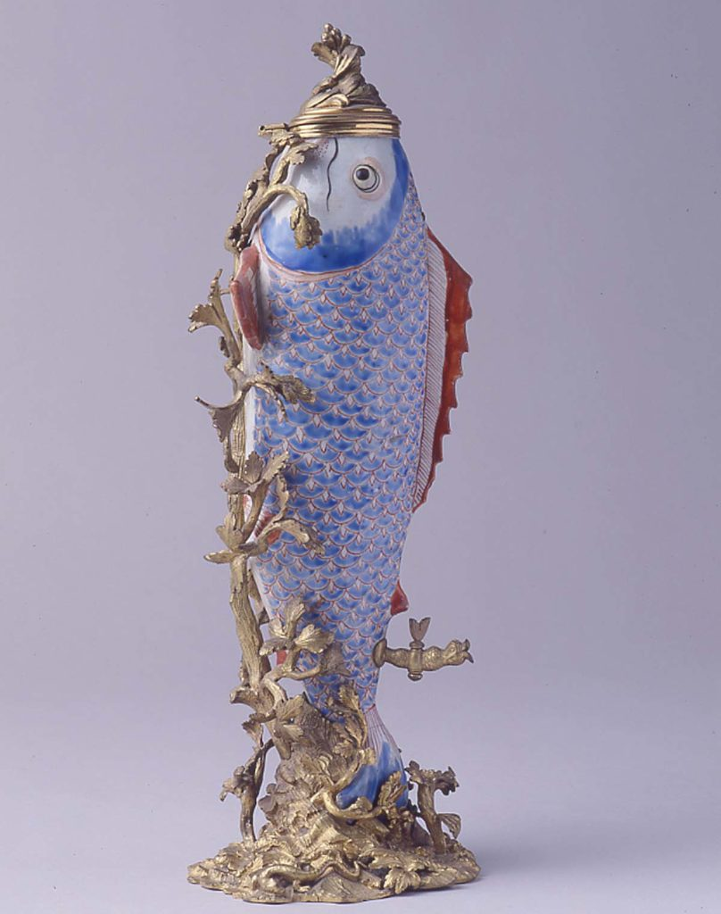 a porcelain fish with added decoration