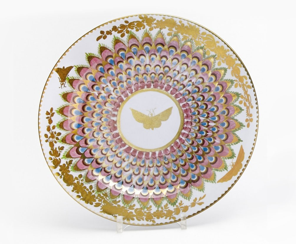 photograph of tin plate with pink and gold butterfly design