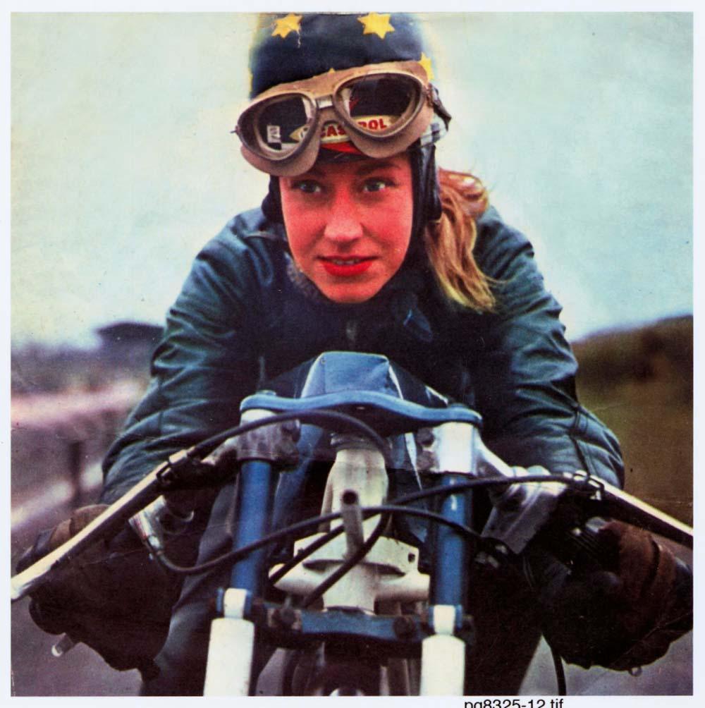 a colour photo f a woman riding a motorcycle