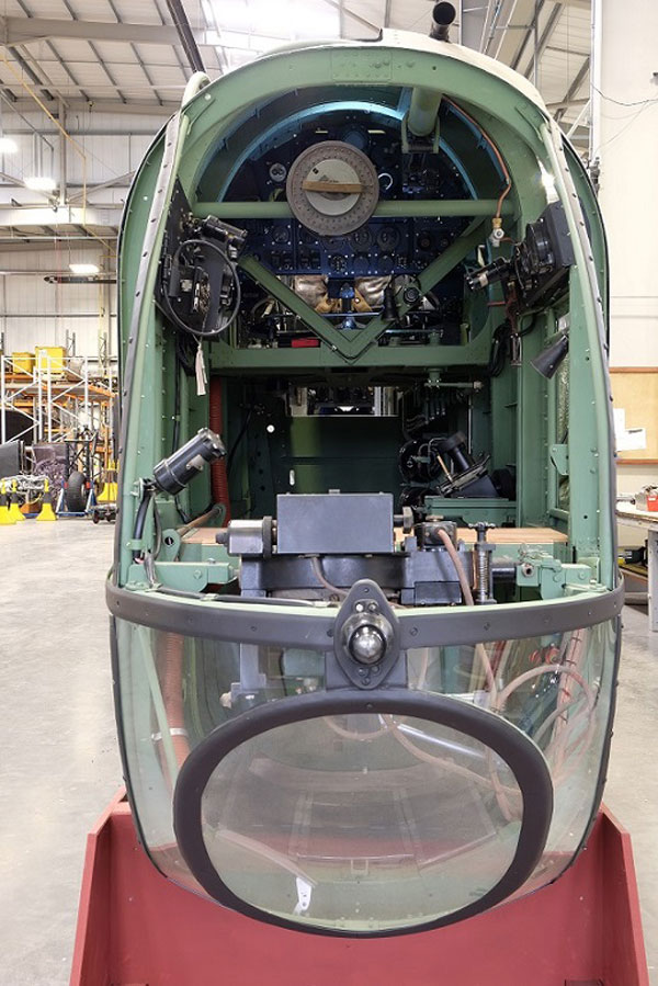 a photo of a compartment in the front end of an aeroplane