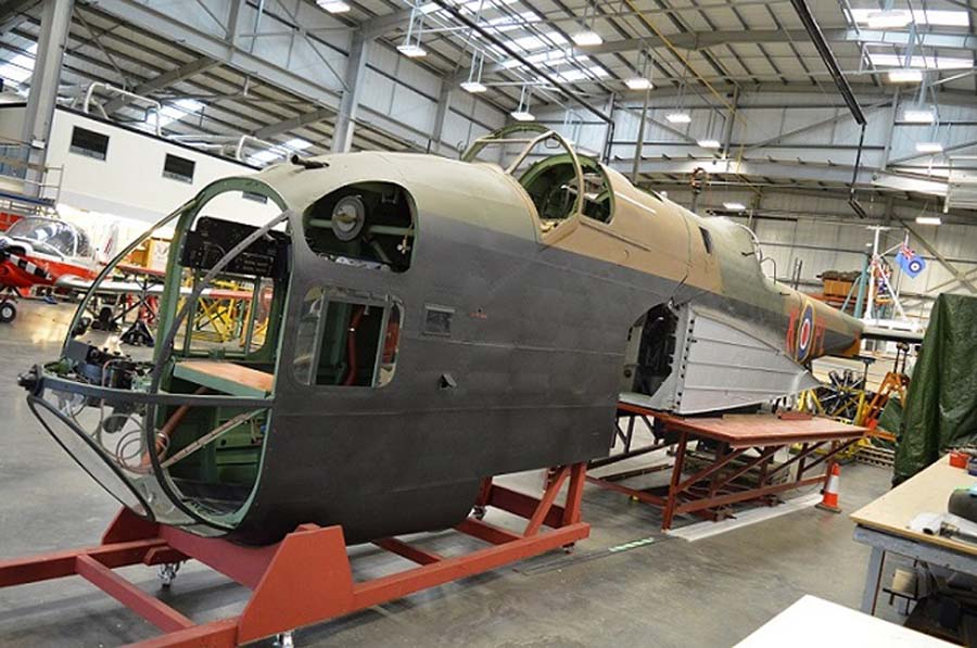 a photo of the forward fuselage of a Britihs bomber painted in camouflage