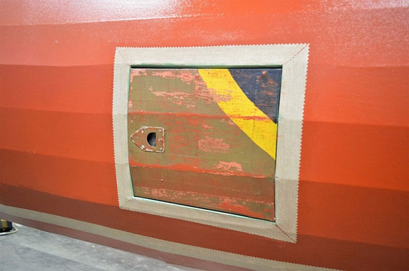 a panel of original paint on the side of a World War Two aeroplane