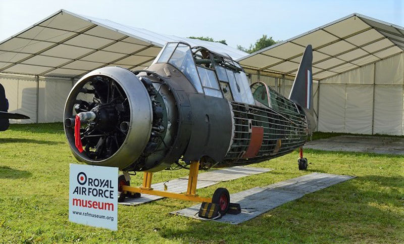 a photo of an aeroplane fuselage on props and on show outside