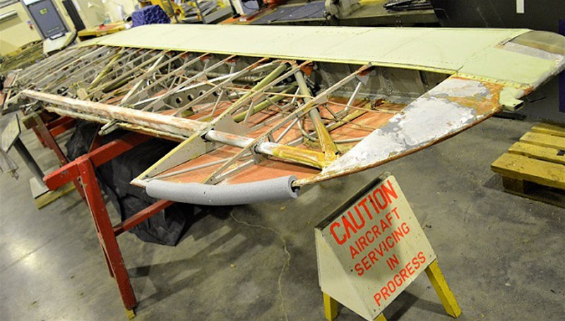 a photo of wooden condtructed aeroplane wing revealing its frame