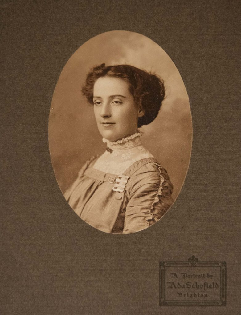 an oval sepia photo of a woman in a mount