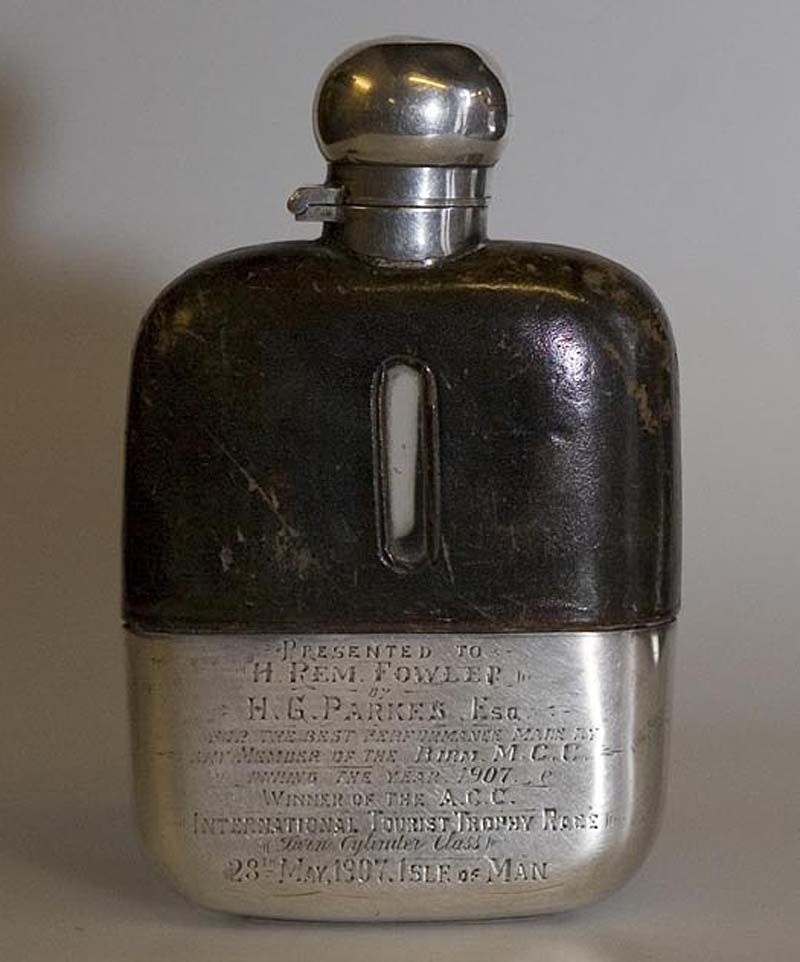 a photo of a half leather covered hip flask with engraving