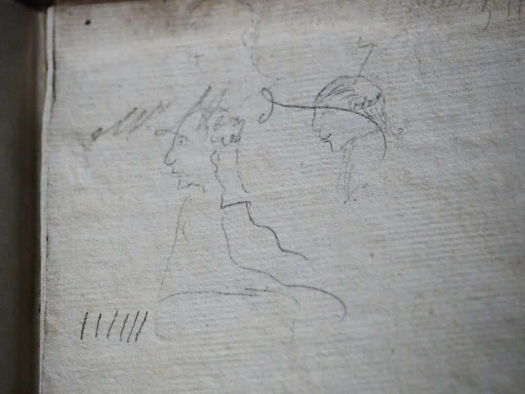 a photo of a book doodle showing the heads and shoulders of two men wearing wigs