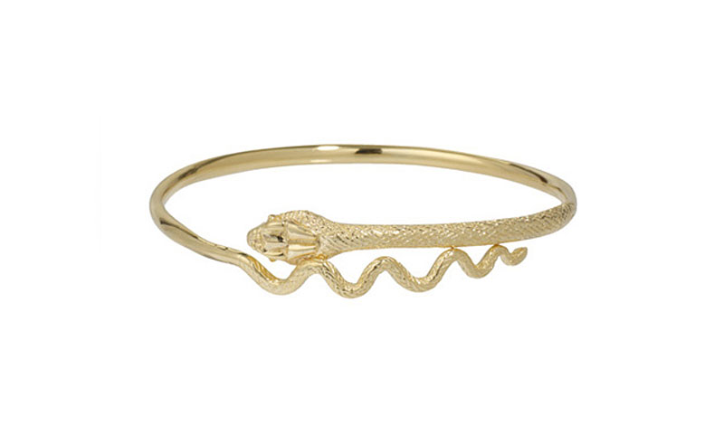 photograph of gold bangle in the shape of a snake