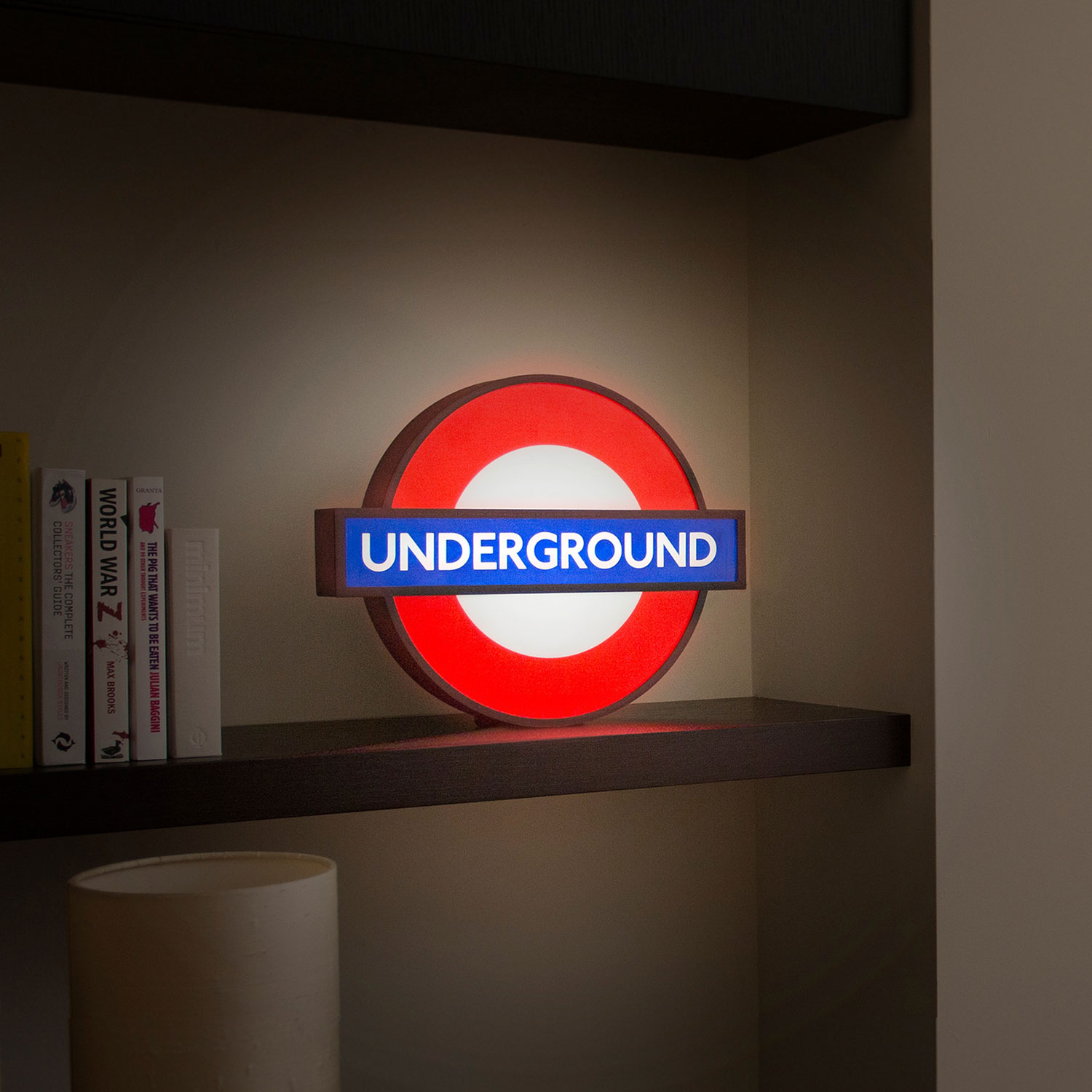 photograph of lightbox in the shape of the london underground roundel sign, reading 'underground'