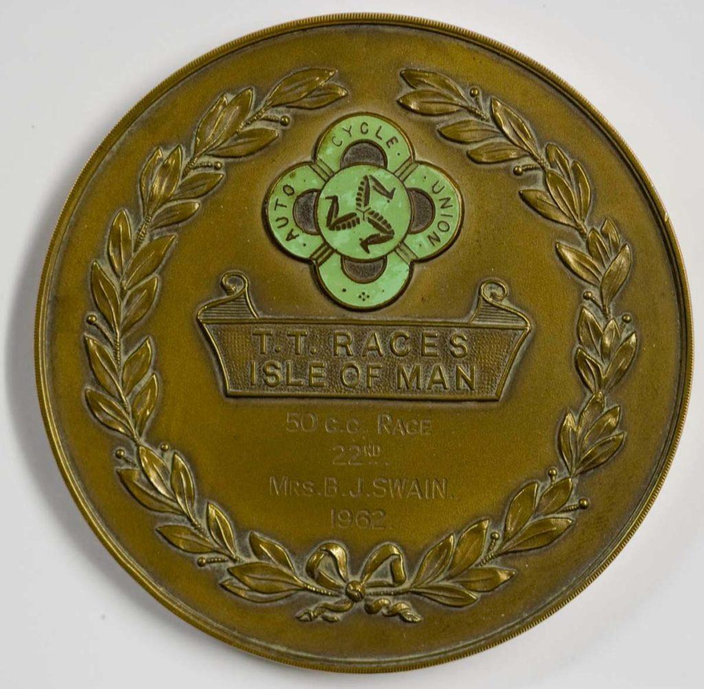 a round bronze medal