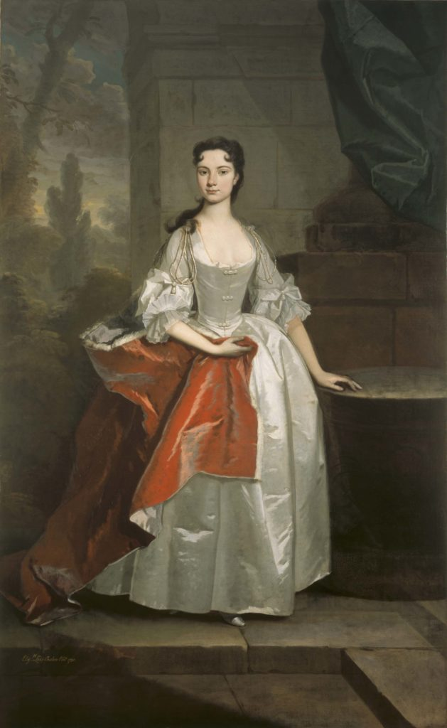 a portrait of woman in a Georgian silk dress and
