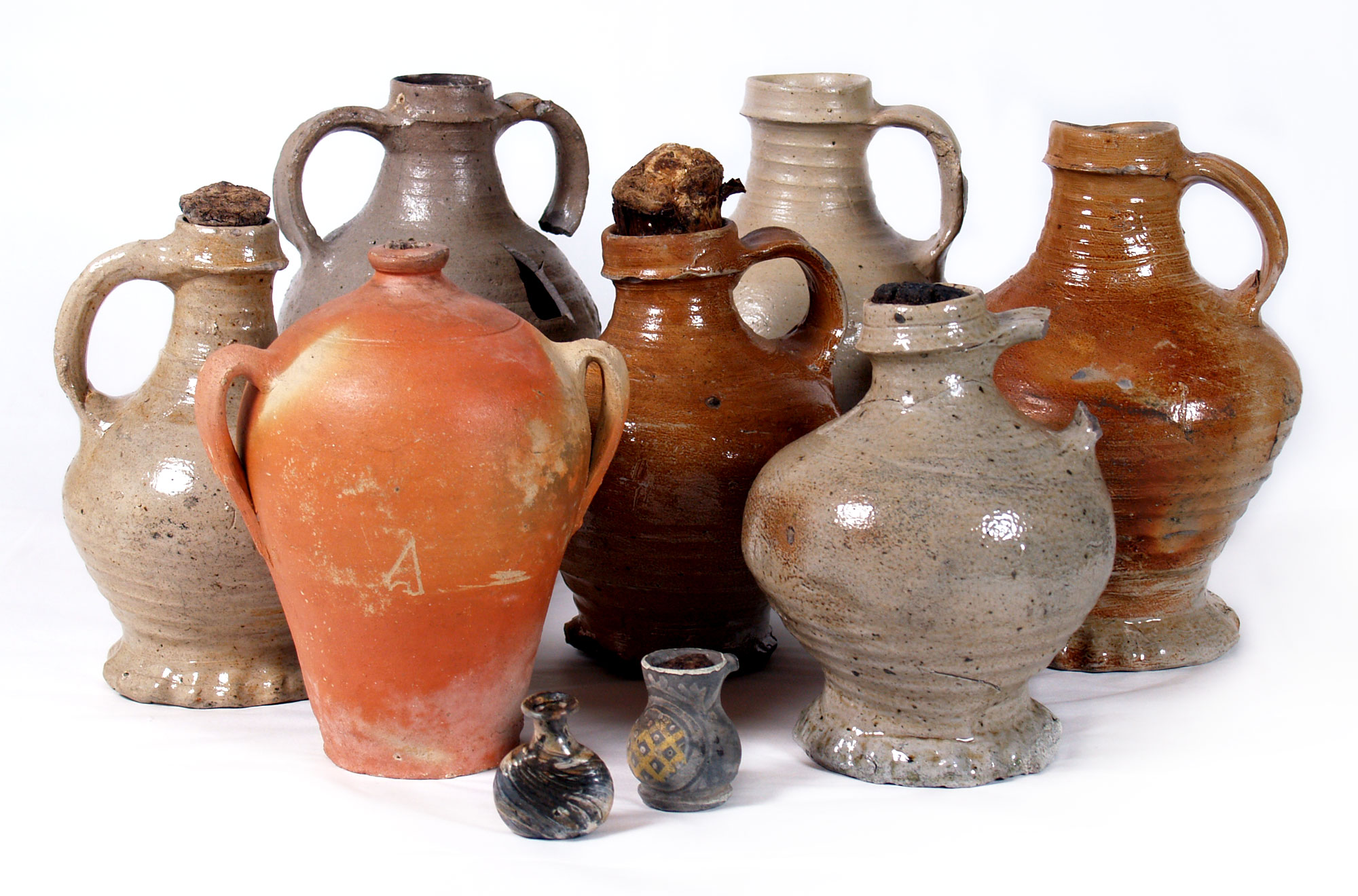 a photo of a group of ceramic jars