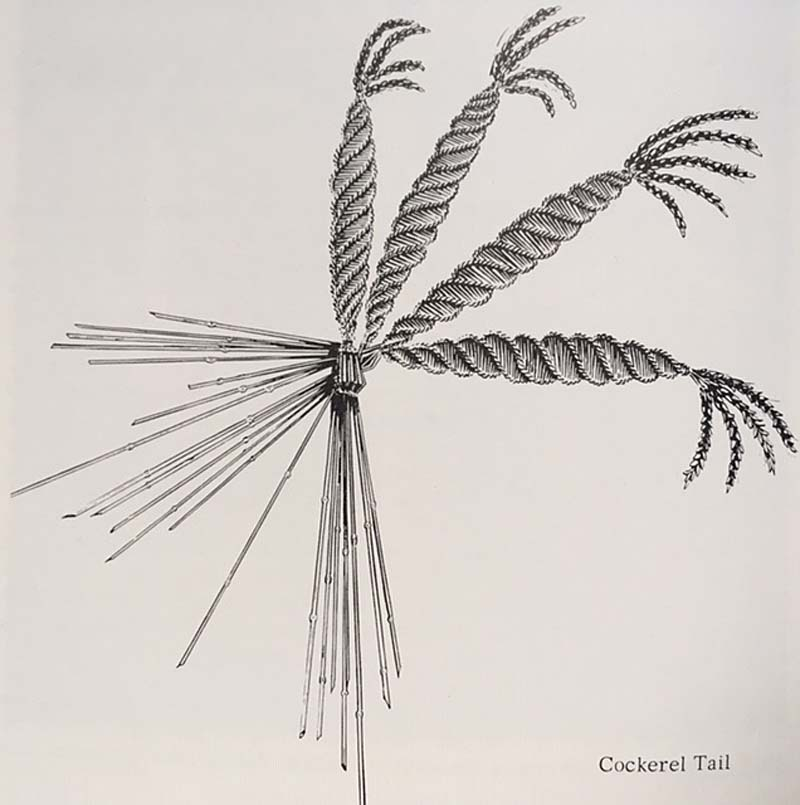 a drawing of pieces of corn woven into a dolly