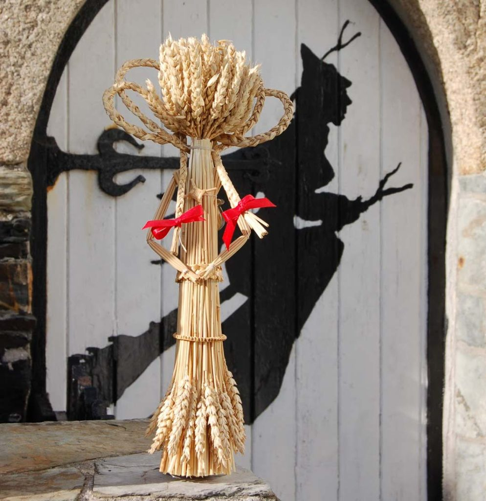a photo of a corn figure with a red ribbon