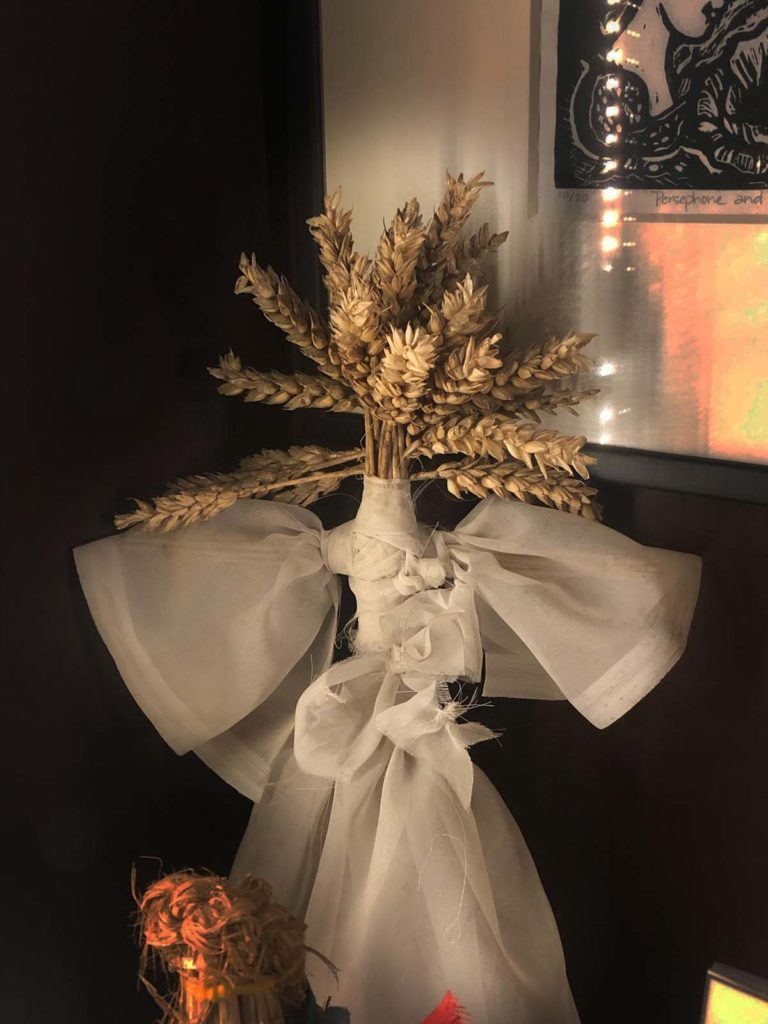 a photo of a corn figure in a white cloth smock