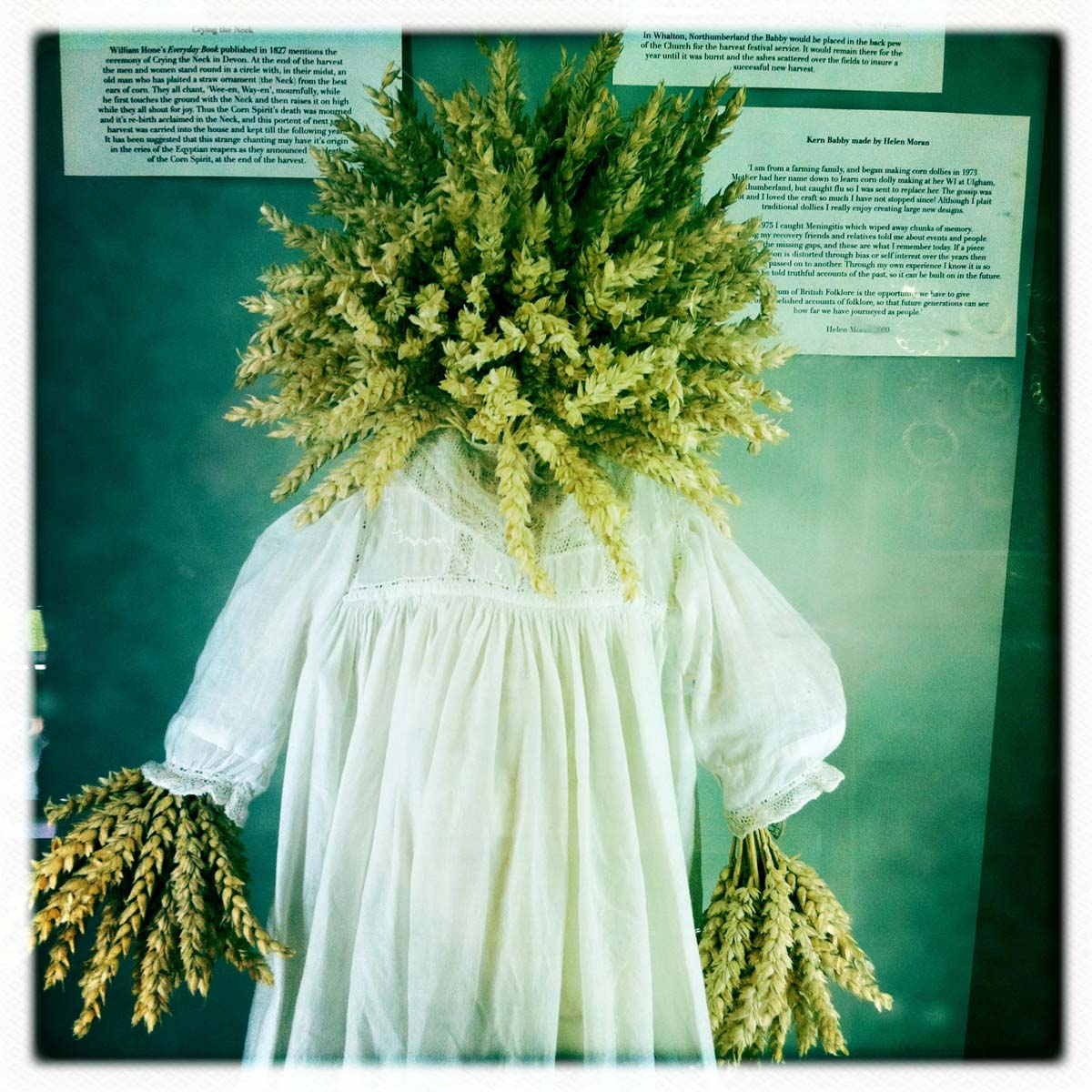 a photo of a corn dolly in a country smock