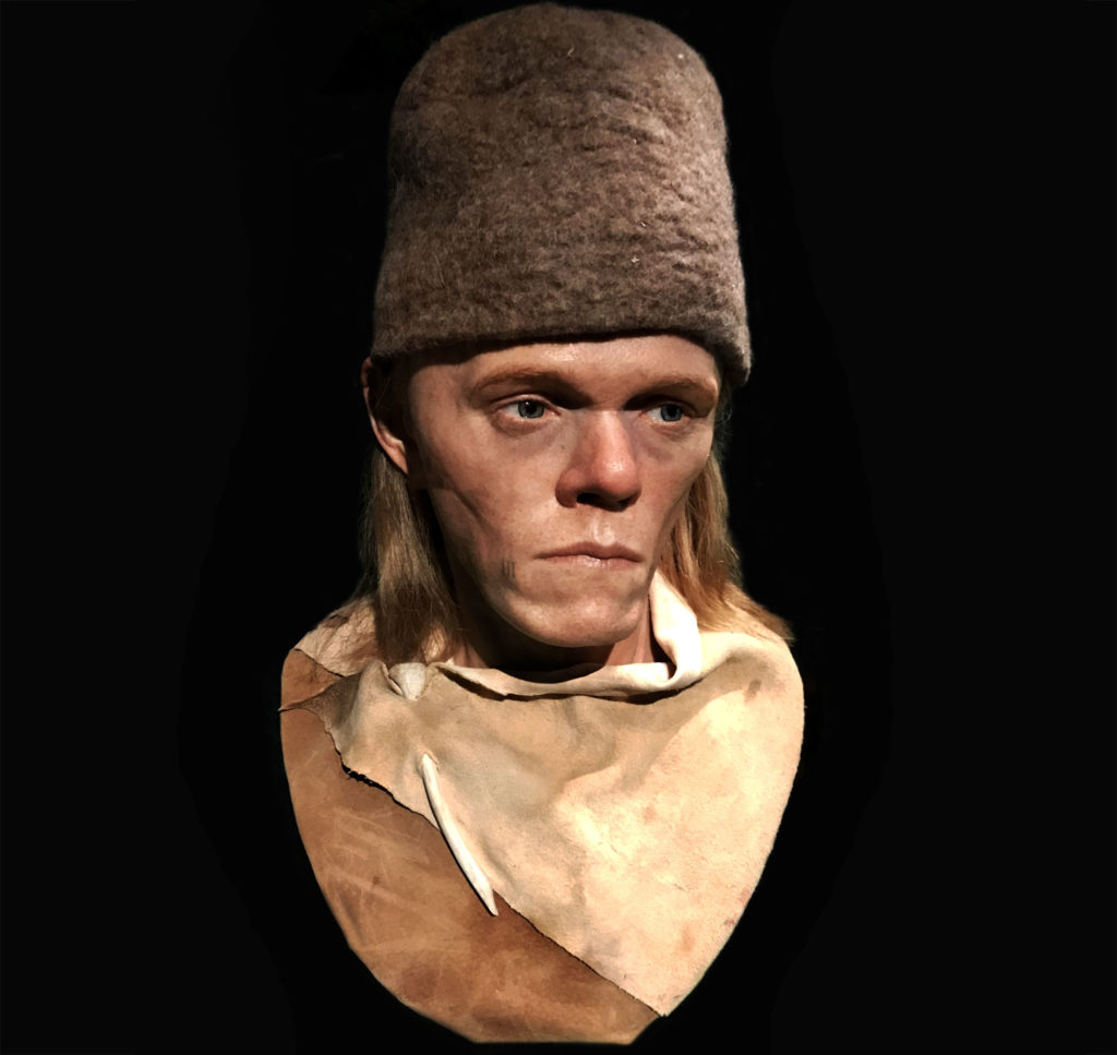 a photo of a reomctrcuted ancinet man with sallow features and pill box type hat