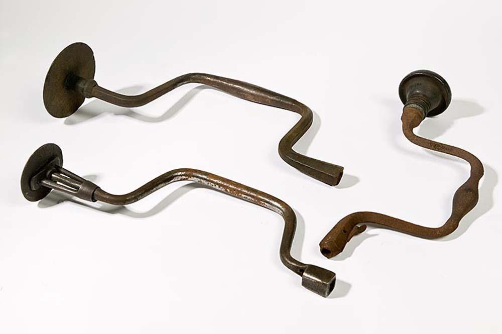 a photo of three hand drills