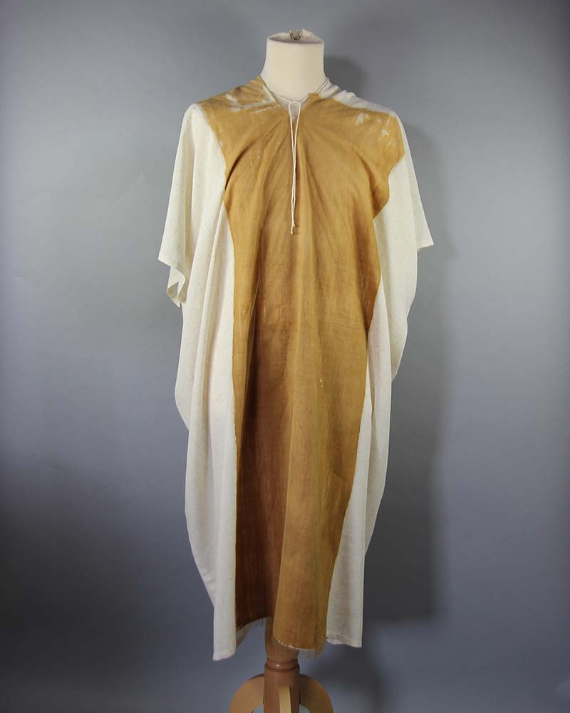 a photo of a long single middle eastern style tunic on a mannequin