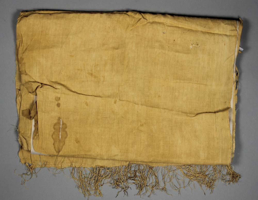 a photo of old linen with fraying to its bottom edge