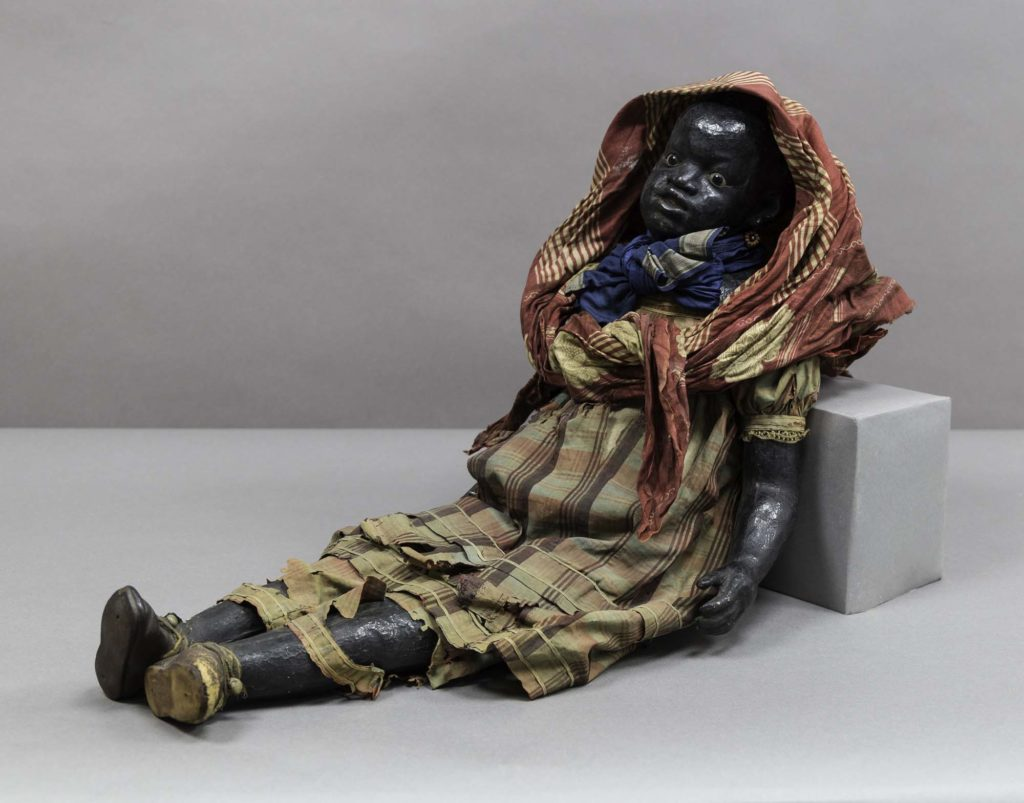 a photo of a large doll reclining