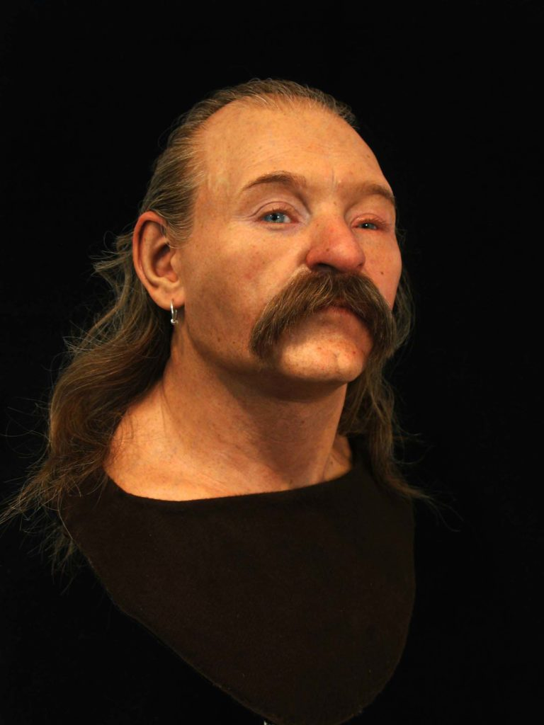 a recreated man wwith long bush moustache and receding swept back hair