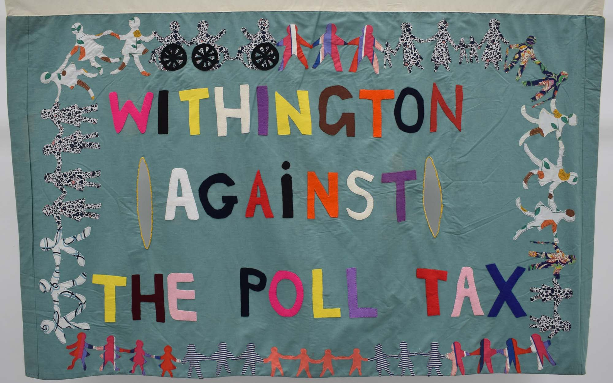 a patchwork banner with the words Withington against the Poll Tax