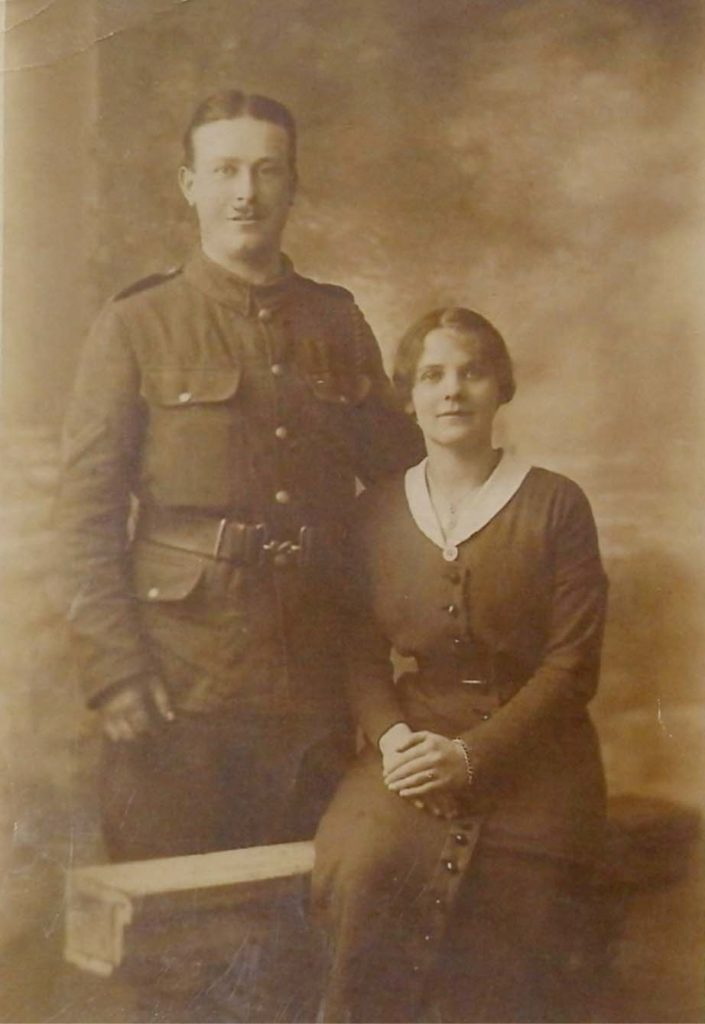 a portrait photo of a man in army uniform and a seated woman