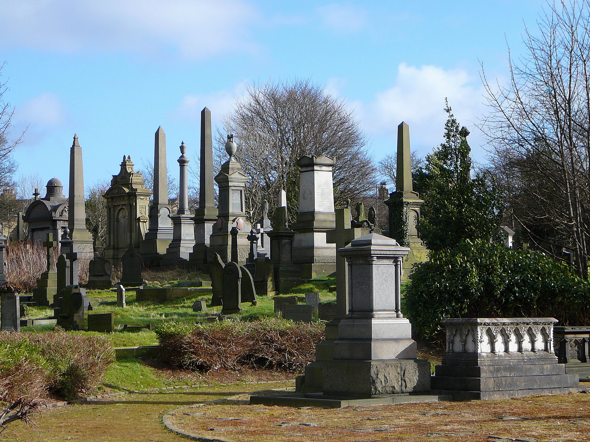 photograph of monuments in a cemetery on a bright day