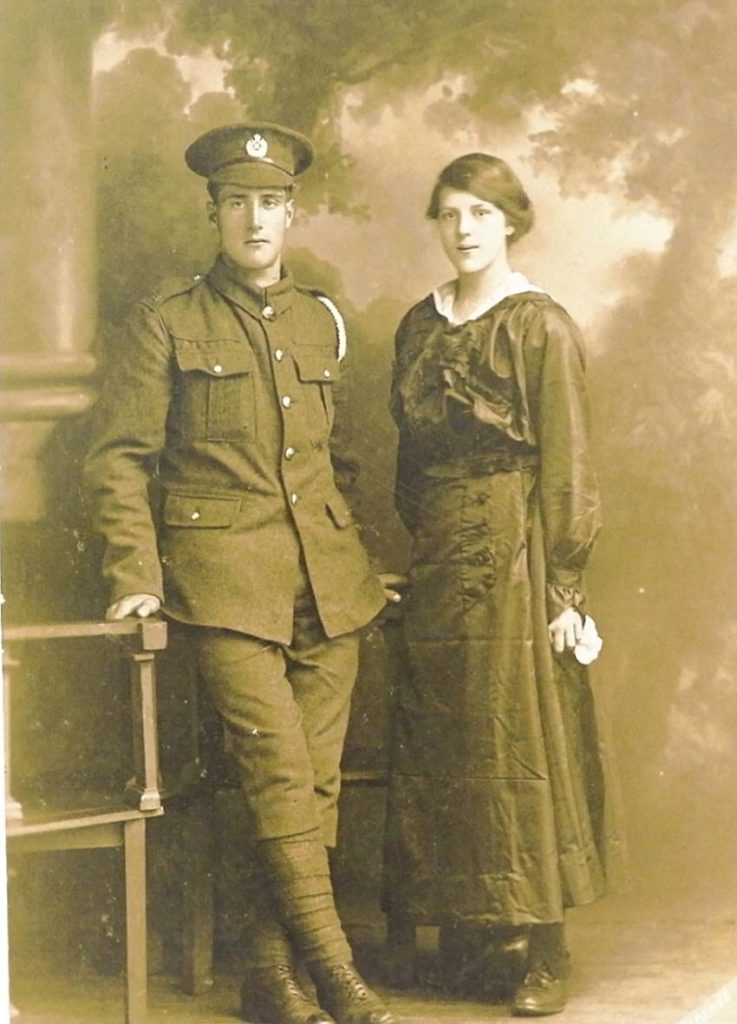 a sepia photo of a soldier and a young woman