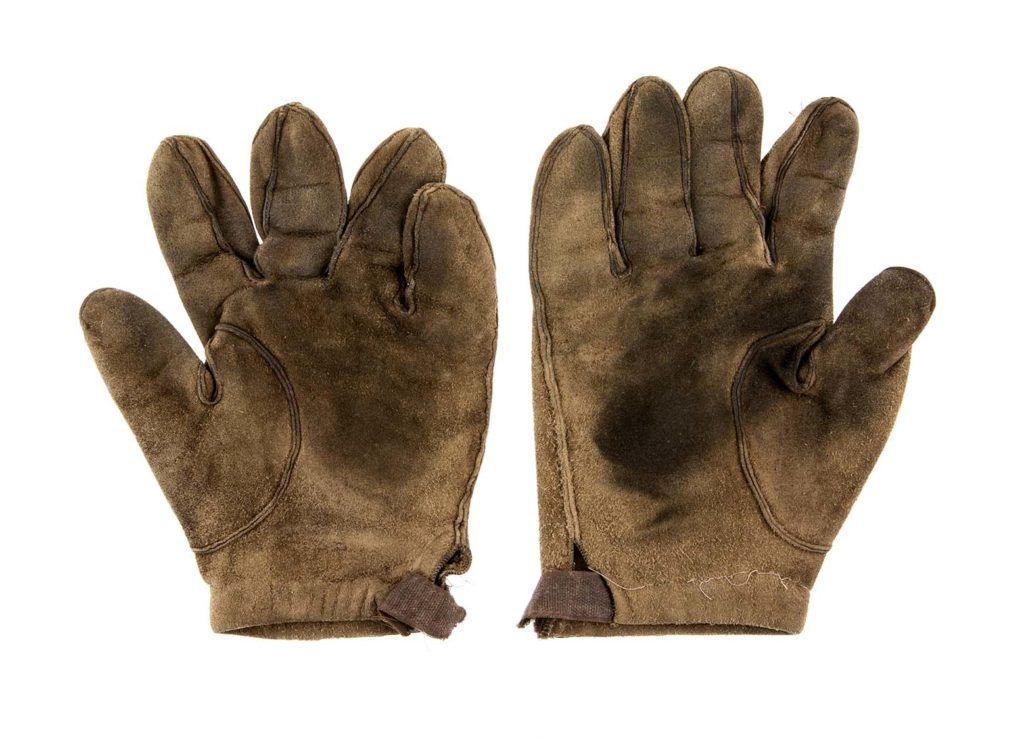 a pair of worn old leather gloves